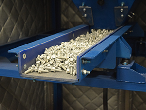 vibratory conveyor feeder for conveying fasteners and bolts