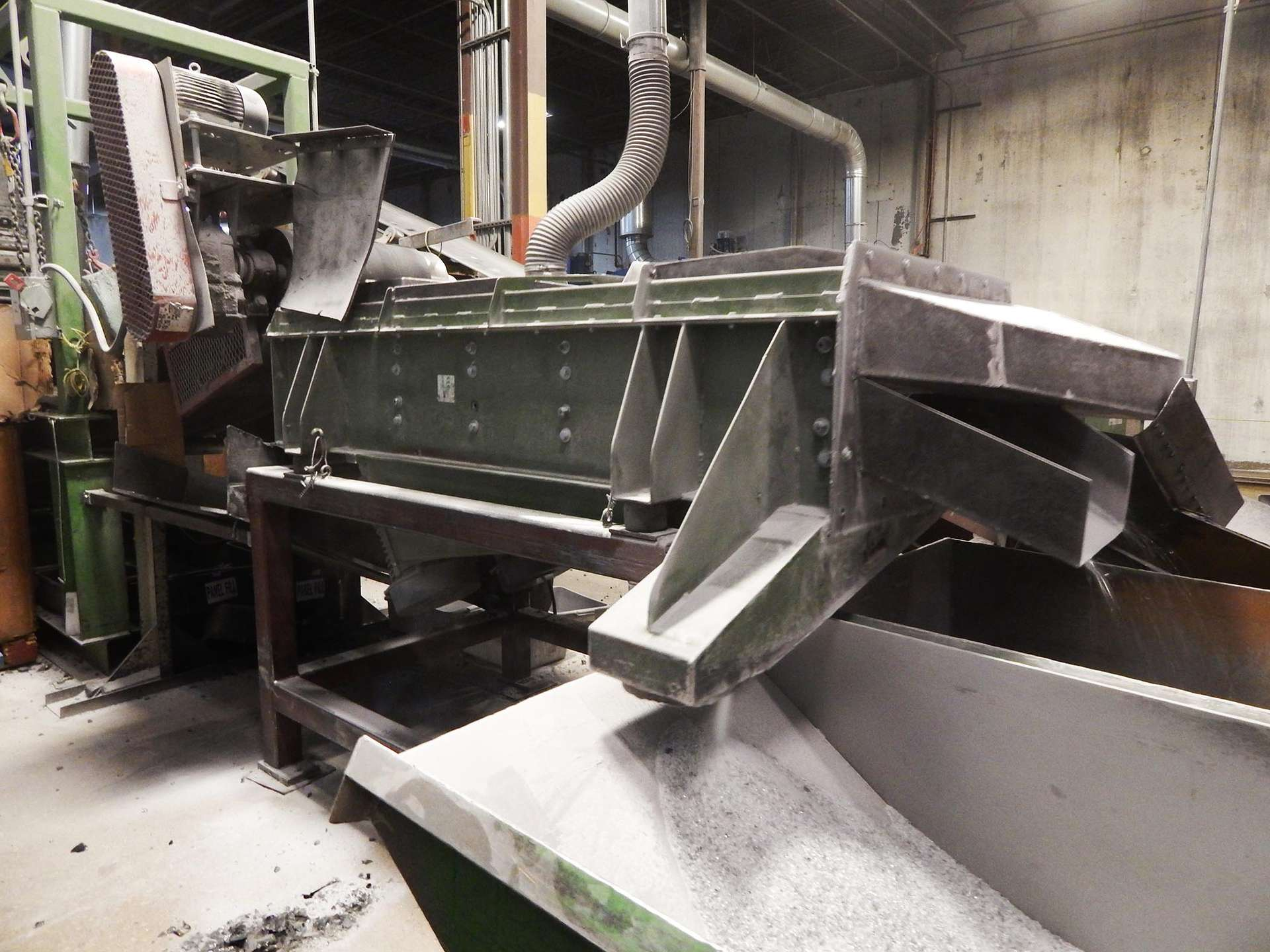 vibratory screener removing fines from materials
